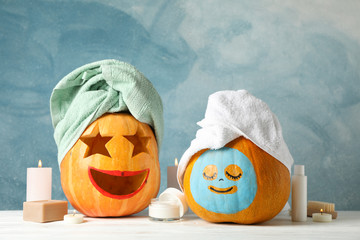 In de dag Spa Funny pumpkins and skin care accessories on white background, copy space