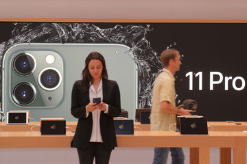 Guests attend the preview of the redesigned and reimagined Apple Fifth Avenue store in New York