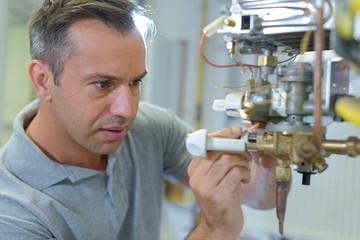 a technician repairing electric boiler