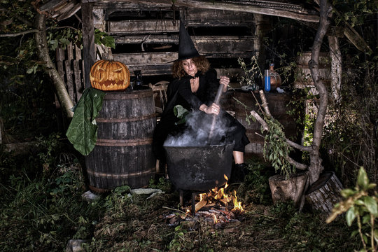 Old witch in her barn brewing potions