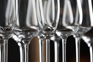 Spoed Foto op Canvas Alcohol Closeup view of empty clean glasses in bar