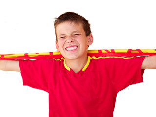 Young supporter boy with shirt of the spanish soccer team