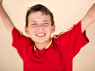Young soccer supporter boy with shirt of the spanish soccer team