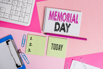 Text sign showing Memorial Day. Business photo text To honor and remembering those who died in military service Writing equipments and computer stuffs placed above colored plain table