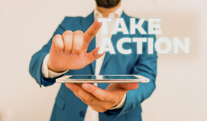 Word writing text Take Action. Business photo showcasing advices someone to do something or reaction right now Businessman with pointing finger in front of him