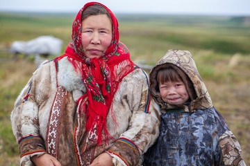 The extreme north, Yamal, the past of Nenets people, the dwelling of the peoples of the north, a family photo near the yurt in the tundra Fototapete