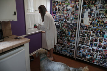 Simah Herman, 18, feeds her dog in her North Hollywood home, Los Angeles