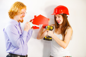 Couple doing house model renovation