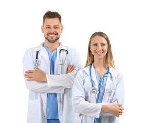 Male and female doctors on white background