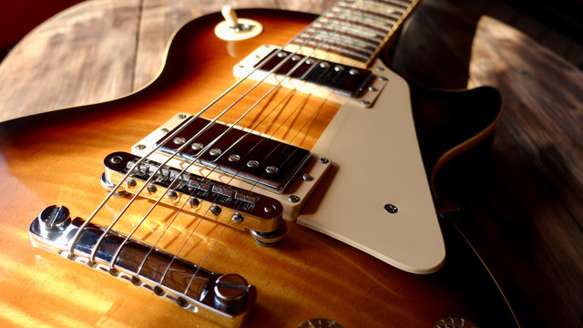 electric guitar on the wooden boards in the sun light