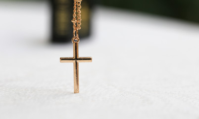 Gold Christ cross lace with holy bible, black cover. European religion conceptual for Christian faith, pray and hope