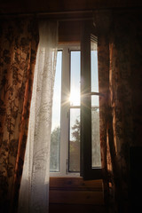 open window on a hot sunny day.