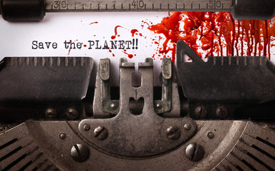 Save the planet, bloody, written on an old typewriter