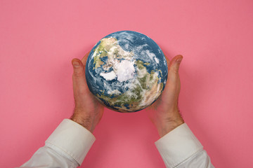 the earth in the hand, pink packground