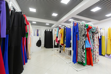 Clothing store with lots of dresses on hangers
