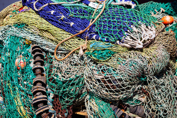 closeup of colorful fishing nets in harbor