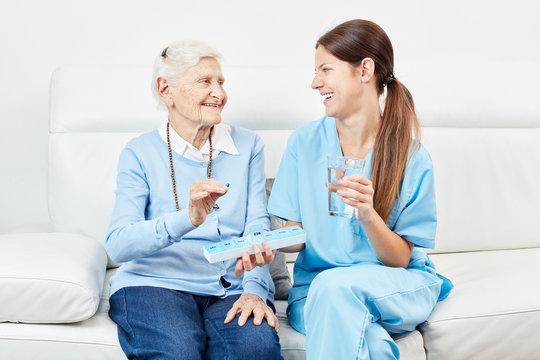 Nurse gives senior medicines