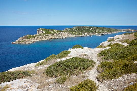 Path, view on Caprara island and lighthouse.