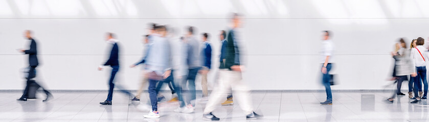Beautiful motion blur of crowd of people walking. Early morning rush hours, busy modern life...