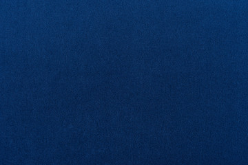 Navy blue dark fabric texture background top view banner.