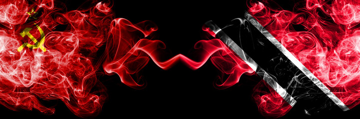 Communist vs Trinidad and Tobago abstract smoky mystic flags placed side by side. Thick colored silky smoke flags of Communism and Trinidad and Tobago