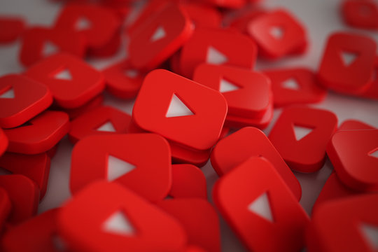 Pile of 3D Play Button Logos