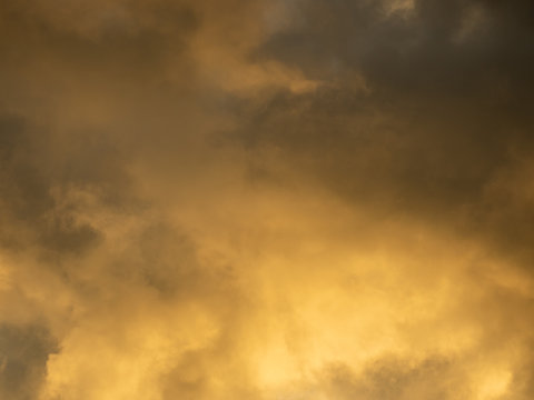 Dramatic yellow sky and dark clouds before a thunderstorm
