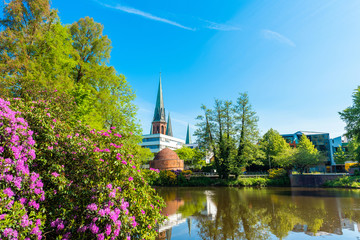 View of the pond and St. Lamberti Church of Oldenburg, Germany.