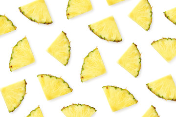 Pattern of pineapple slices isolated on white background