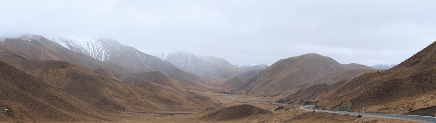 Lindis Pass Snow Capped during snow fall on road South Island New Zealand
