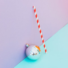 Silver decoration ball with candy stick. Conceptual Christmas and New Year idea