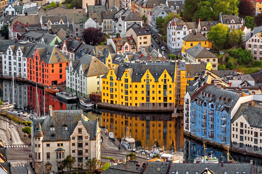 Alesund is a port and tourist city at the entrance to the Geirangerfjord.  Cityscape image of Alesund  at dawn.