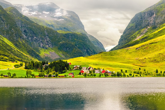 Summer cloudy evening fjord landscape, Norway.