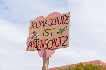 A sign with the inscription Climate protection is species protection.