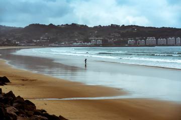 Surfer and rain on the beach, Fontarabie