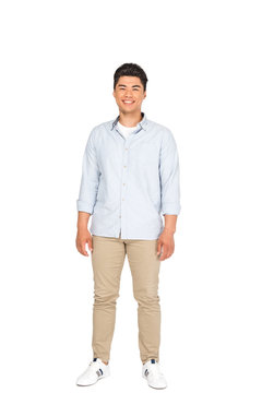 full length view of happy asian man looking at camera on white background