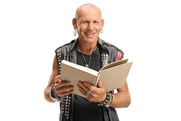 Punker in leather vest holding a book and smiling at the camera