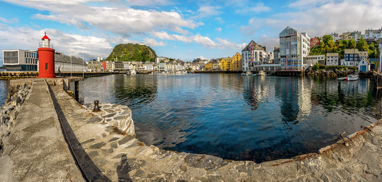 Alesund port town on western coast of Norway, Pier and lighthouse.