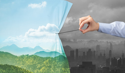 hand pulling nature cityscape curtain to gray cityscape, environmental protection concept Fotobehang