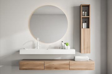 White bathroom interior with sink and mirror
