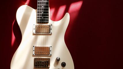 Papiers peints Rouge, noir, blanc white electric guitar . color background with copy space