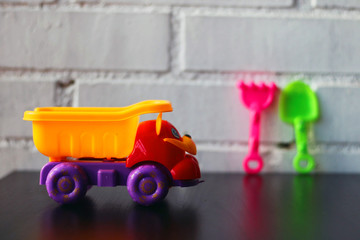 Toy truck on a table.