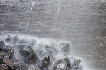 The Snow Waterfall waters falling in high volume on rocks