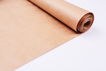 Twisted into roll brown wrapping paper white background