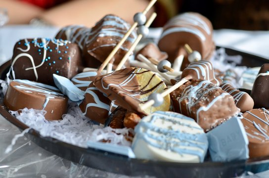 Dessert cookies and chocolate dipped marshmallows during a baby shower