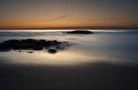 Long exposure of the Atlantic ocean during sunrise in Belmar New Jersey