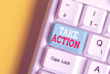 Writing note showing Take Action. Business concept for advices someone to do something or reaction right now White pc keyboard with note paper above the white background