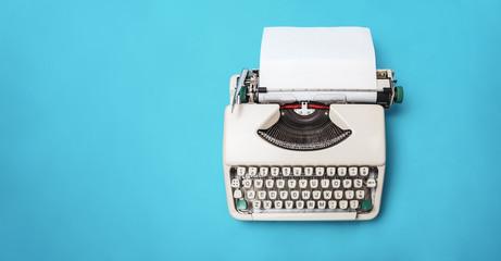 Vintage Sixties typewriter on a teal background