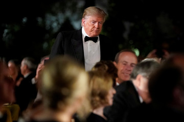 U.S. President Donald Trump greats guests during a state dinner for Australia's Prime Minister Scott Morrison in the Rose Garden of the White House in Washington