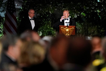 U.S. President Donald Trump and Australia's Prime Minister Scott Morrison toast each other at a state dinner at the White House in Washington